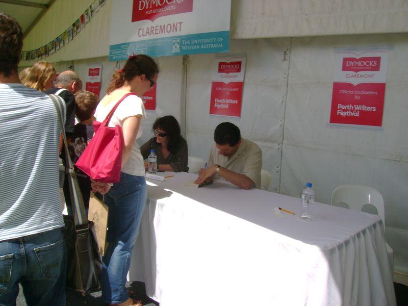 Imran signing books