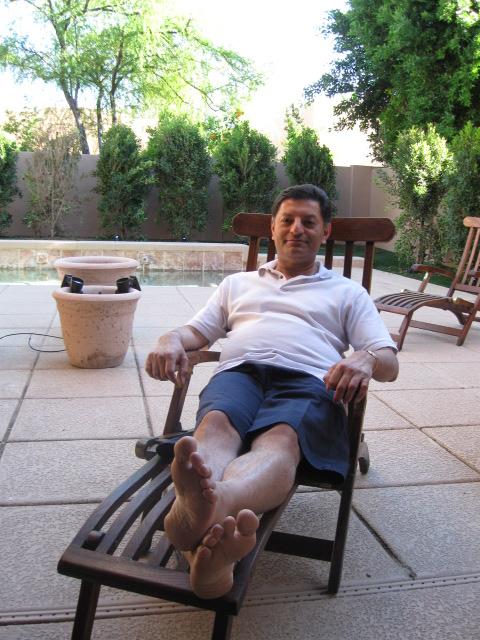 Imran relaxing by pool in Scottsdale